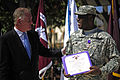 Defense.gov News Photo 110928-F-RG147-204 - Deputy Secretary of Defense William J. Lynn III congratulates Pfc. Milton Jenkins after presenting him the Purple Heart during a ceremony at the.jpg