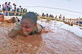 Defense.gov News Photo 120114-F-CB366-912 - Senior Airman Danielle Sturdivant with the 56th Communications Squadron at Luke Air Force Base Ariz. crawls through the electric eel obstacle.jpg