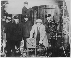 Civil forfeiture in the United States - During Prohibition, Detroit police inspect equipment suspected of being used to make alcohol; under civil forfeiture laws, police could seize the equipment without having to charge any owners with a crime.