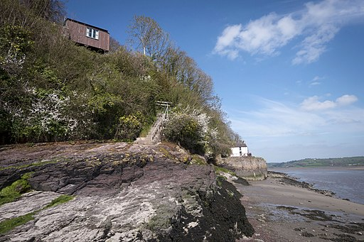 Dylan Thomas (1914-53) lived and worked at his Boathouse with its clifftop writing shed and spectacular views in the seaside town of Laugharne on the fringes of Carmarthen Bay. (17247880856)