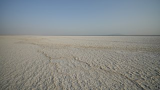 Flat expanse of ground covered with salt and other minerals