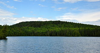 Eagle Mountain (Minnesota) - The 2,301-foot Eagle Mountain, seen across Whale Lake. July 2014.