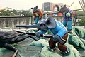 Elephant with rifle, mouse with pistol, Haw Par Villa (14607278200).jpg