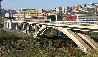 Metro Bilbao - Bolueta Station (L1 and L2) constructed on a bridge above the Nervion river.