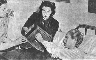 "1951 Argentine general election - The ailing Eva Perón (right) casts a vote for the ""reason of her life,"" President Juan Perón."
