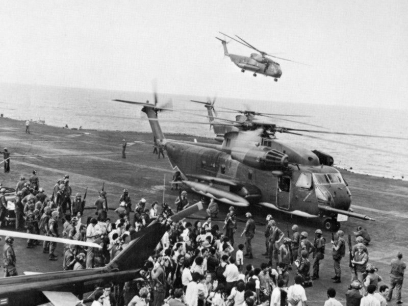 Evacuees offloaded onto the USS Midway