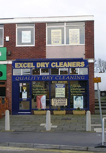 English: Excel Dry Cleaners - New Road Side