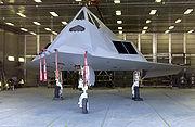 Aircraft parked inside an open hangar