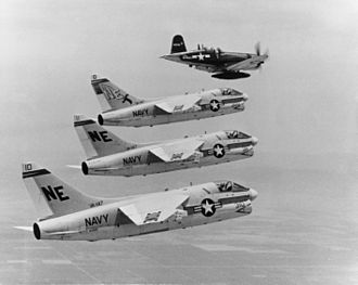 "LTV A-7 Corsair II - Lynn Garrison in a Chance Vought F4U-7 Corsair leads A-7 Corsair IIs of VA-147, over NAS Lemoore, California on 7 July 1967 prior to the A-7's first deployment to Vietnam on USS Ranger. The A-7A ""NE-300"" is the aircraft of the Air Group Commander (CAG) of Attack Carrier Air Wing 2 (CVW-2)."
