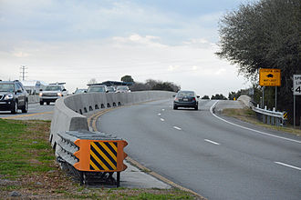 F.J. Torras Causeway - The end of the F. J. Torras causeway at St. Simons Island.  Openings in the barrier for turtle crossing are visible.