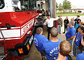 Fire Inspector Lucas Free gives local Texas students a tour of an aviation fire truck.jpg
