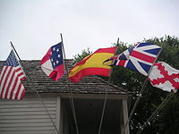 Five flags have flown over the city since 1565. From left: U.S., Confederate, Spanish (after 1785) British, and the Spanish (before 1785) Burgundy Cross