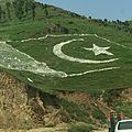 Flag on a mountain on the way to Naran.JPG