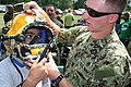 Flickr - Official U.S. Navy Imagery - A Navy diver demonstrates diving equipment to a young volunteer..jpg