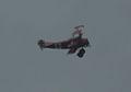 Fokker Dr.I Manfred Richthofen Flyby 02 ThruDirtyWindow Dawn Patrol NMUSAF 26Sept09 (14596627841).jpg