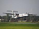 G-ECOA Flybe De Havilland Canada DHC-8-402Q Dash 8, landing on Schiphol (EHAM-AMS) runway 18R pic2.JPG