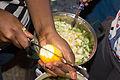 Garden eggs being sliced for boiling.jpg