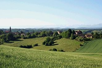 Gascony - Typical view of the hilly countryside of Gascony, with the Pyrenees mountains in the far distance