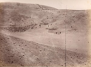 Battle of San Juan and Chorrillos - After the battle, Chilean soldiers standing on the Peruvian defense line, top on the hills. Dead bodies at the bottom of the valley.