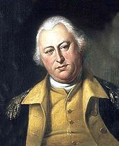 A portly, white-haired man wearing a black jacket with gold epaulets, a gold vest, and a high collared, white shirt