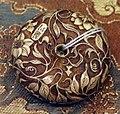 Giappone, periodo edo, netsuke (fermaglio per inroo), xix secolo, 111 fiori.jpg