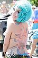Girl with green hair and tattoos Mermaid Parade 2012.jpg