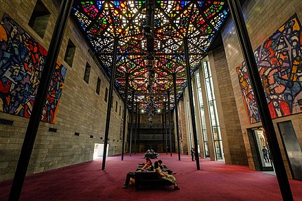 The Great Hall ceiling, the world's largest stained-glass ceiling, designed by Melbourne artist Leonard French Great Hall NGV 2014.jpg