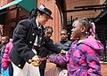 Gunner's Mate Seaman Amada Williamson shows her cutlass to children. (14090933516).jpg