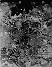 Aerial reconnaissance picture showing the Gusen I and II camps, marked with numbers and arrows pointing to some of the objects.