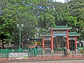 HK Yau Ma Tei Shanghai Street ERB banner n YMT Community Centre chinese gate n banyan trees Feb-2014 street lamp light.JPG