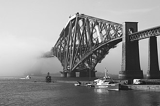 Haar (fog) - Haar rolls into the Firth of Forth, partially shrouding the Forth Bridge.
