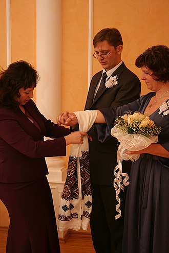 Handfasting (Neopaganism) - Civil wedding ceremony in Ukraine. The cloth is a ceremonial rushnyk decorated with traditional Ukrainian embroidery.