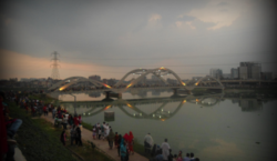 The second bridge of Hatirjheel with a dense population of people (second day of Eid al-Adha, 2013, just before sunset)