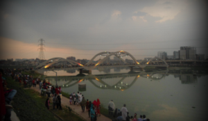 Hatirjheel - A beautiful view of the second bridge of Hatirjheel with a dense population of people (second day of Eid al-Adha, 2013, just before sunset)