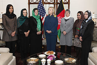 Women's rights in Afghanistan - U.S. Secretary of State Hillary Clinton standing with Afghan female politicians, which includes Fauzia Koofi with the green headscarf on her right and Sima Samar to her left.