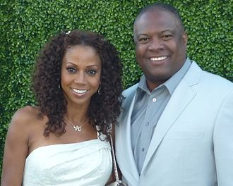 Rodney Peete - Rodney Peete with his wife Holly Robinson Peete in 2010