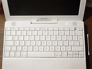 iBook with alpha and punctuation keys manually rearranged to the Dvorak layout.