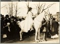 Inez Milholland Boissevain, wearing white cape, seated on white horse at the National American Woman Suffrage Association parade, March 3, 1913, Washington, D.C. LCCN97510669.tif