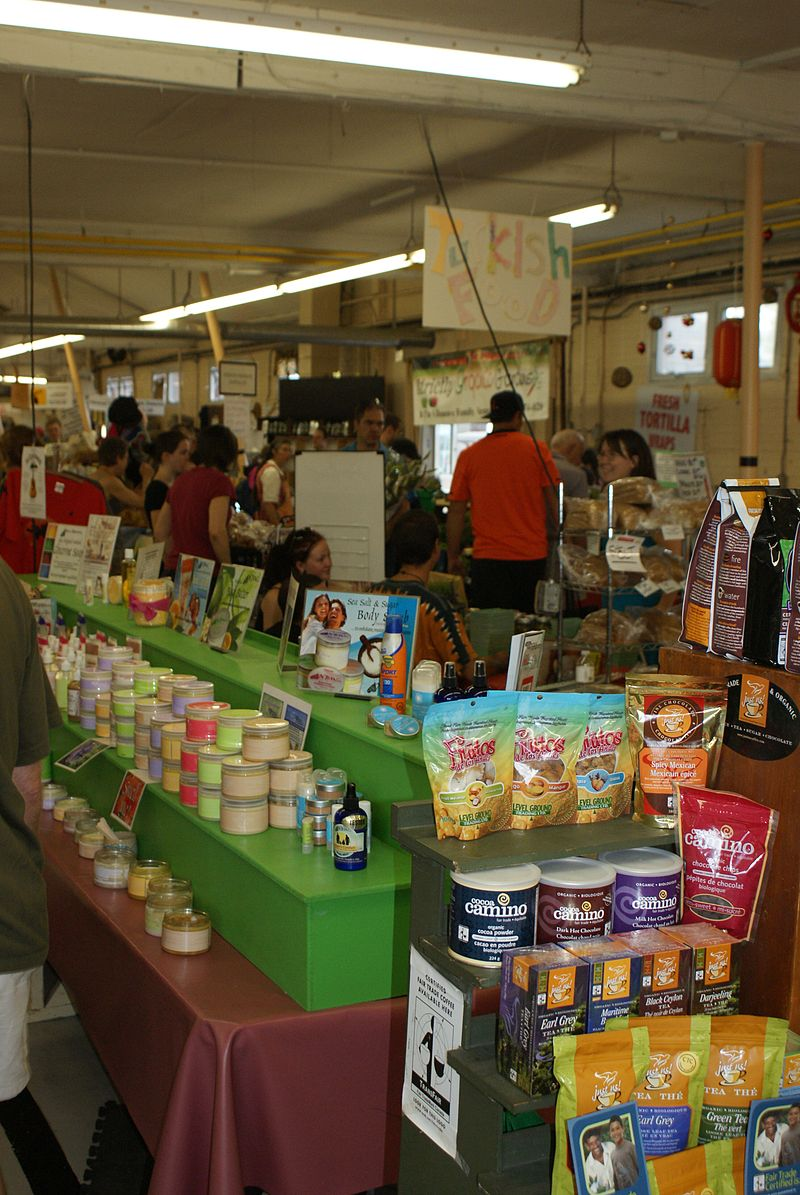 A setup of coffee and bath/body products inside the market.