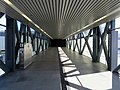 Interior of north pedestrian bridge at West Dublin Pleasanton station, May 2018.JPG