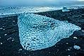 Jökulsárlón ice beach sunset (15847153234).jpg