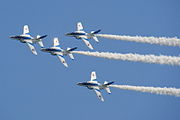 Japan air self defense force Kawasaki T-4 Blue Impulse RJST Single Cloverleaf Turn.jpg