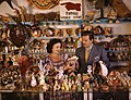 John M. Gonatos in his curio shop with assistant Niki Vasilikis- Tarpon Springs, Florida (8342352776).jpg