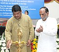 Jual Oram lighting the lamp at a meeting on effective and efficient implementation mechanism of schemes of Ministry of Tribal Affairs for development of Tribals, in New Delhi. The Minister of State for Tribal Affairs.jpg