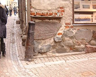 Prehistory and origin of Stockholm - U 53, a fragment of a runestone built into a wall in the intersection of Prästgatan and Kåkbrinken, is believed to have been brought from an Iron age settlement not far from today's old town.