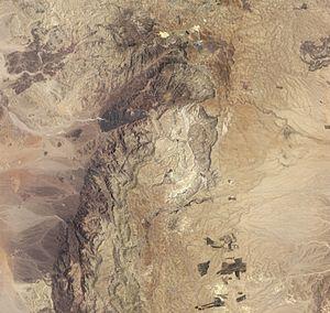 Khirbat en-Nahas - Black piles of slag define Khirbat en-Nahas in this satellite image.