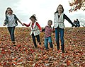 Kids family having fun in the leaves at a Virginia State Park - cropped Optoutside2016 (32798254202).jpg