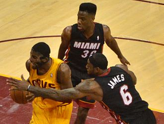 Norris Cole (basketball) - Cole in a game with teammate LeBron James and opposing point guard Kyrie Irving of the Cleveland Cavaliers.
