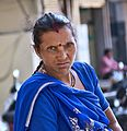 Lady at the Market (11820372066).jpg
