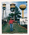 Larry Long standing in front of Okemah Water Towers.jpg